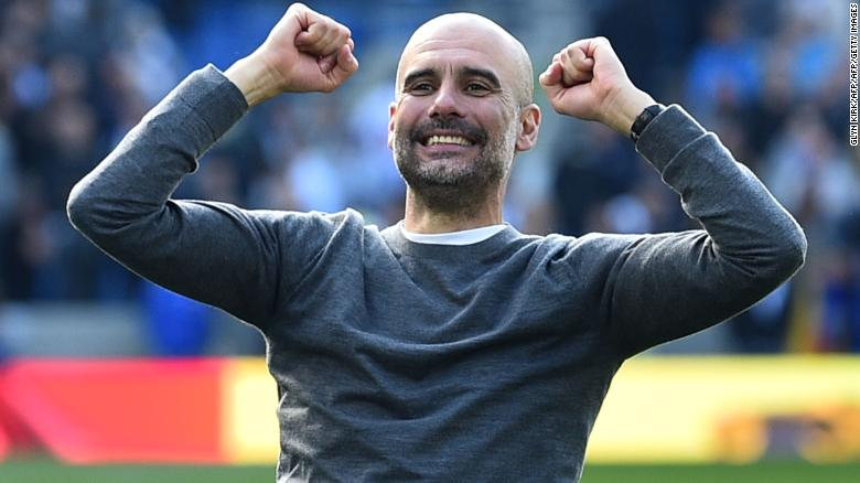 Pep Guardiola celebrates winning his second title with Man City