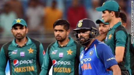 Rohit Sharma, who captained India in Virat Kohli's absence against Pakistan at the 2018 Asia Cup, leaves the field after masterminding his team's victory.