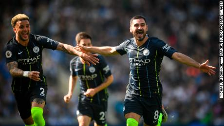 Manchester City celebrate winning the EPL title after victory against Brighton.