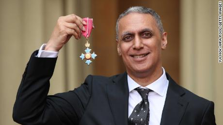 Nitin Sawhney holds his CBE for services to music at Buckingham Palace on May 9, 2019 in London, England.