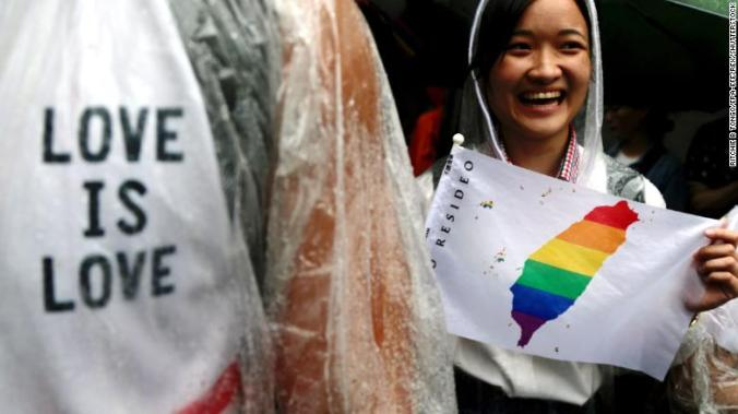 Supporters of same-sex marriage gather outside as parliamentarians debated in Taipei, Taiwan, on Friday.