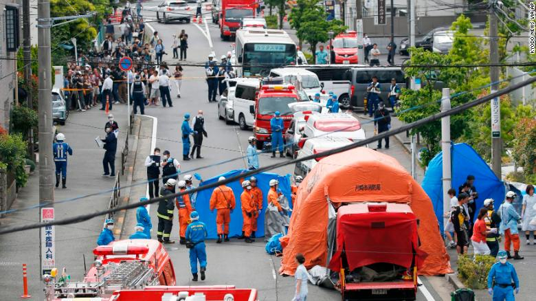 Rescuers work at the scene of an attack in Kawasaki, near Tokyo on Tuesday, May 28.