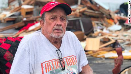 Ron Jones sits near what's left of his home after an EF-4 tornado hammered Linwood.