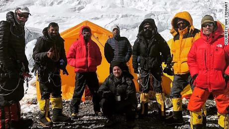 Robin is pictured third from right, in black, among a group of other climbers.
