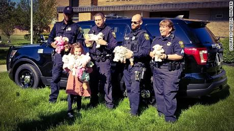 Police officers in Euclid, Ohio, accept Alex Walker's stuffed animals to distribute to kids during emergency calls.