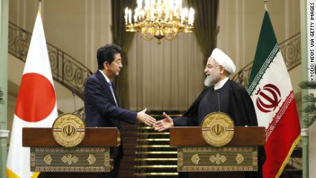Japanese Prime Minister Shinzo Abe, left, and Iranian President Hassan Rouhani shake hands after a joint press conference in Tehran.