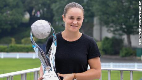 Ashleigh Barty poses with the WTA world No.1 trophy.