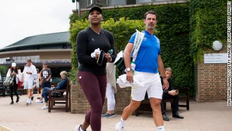 """Patrick Mouratoglou (right) has called on tennis' governing bodies to find a """"sustainable solution"""" for lower-ranked players."""