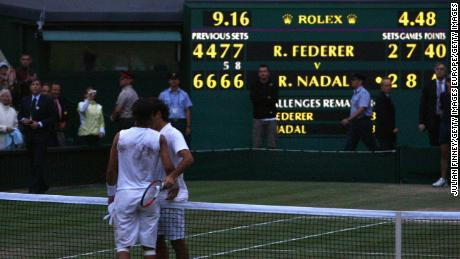 Federer and Nadal greet each other at the net after their marathon 2008 Wimbledon final.