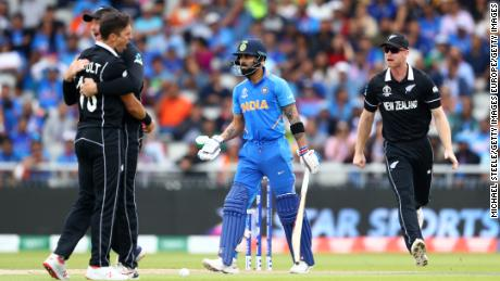 Trent Boult of New Zealand celebrates bowling Virat Kohli of India lbw.