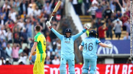 Joe Root  celebrates as Eoin Morgan of England scores the winning runs to secure victory.