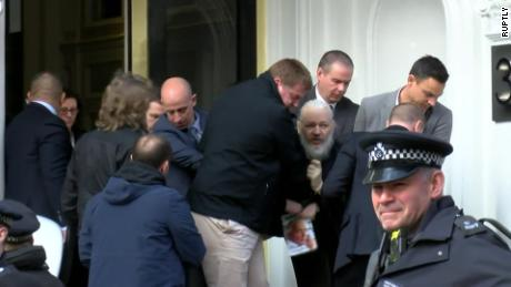 Police remove Julian Assange from the Ecuadorian Embassy in London on April 11, 2019.
