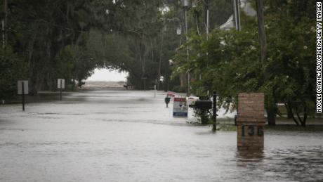 Barry weakens to a tropical depression, but authorities still warn of dangerous flooding