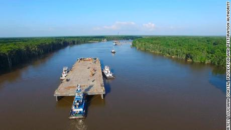 The barge traveled 8 miles to its sinking destination in Bayou Chene. Submerging it took roughly eight hours.