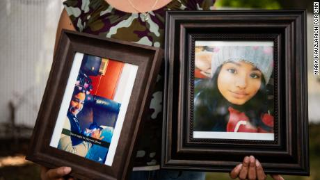 Jessica Gámez Garcia holds photos of her niece Heydi Gámez Garcia in the backyard of her home on Long Island.