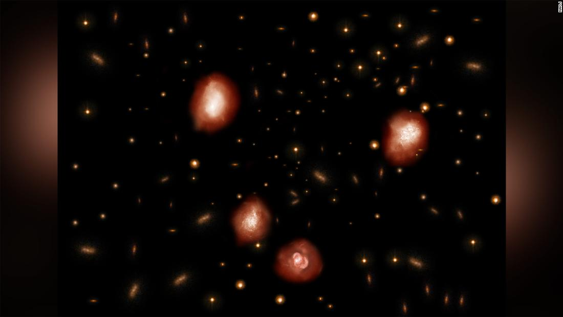 This is an artist's impression of the ancient massive and distant galaxies observed with ALMA.
