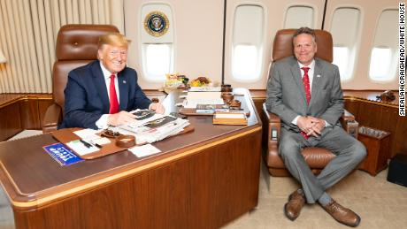 Alaska Gov. Mike Dunleavy, here with President Trump aboard Air Force One, was used as a go-between with the White House, the mine executives said.
