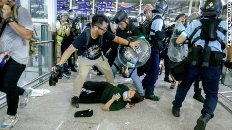 Officers and protesters clash at the airport on Tuesday night.