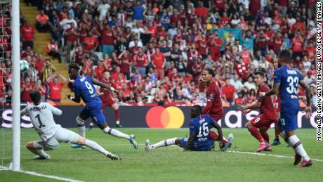 Virgil van Dijk is denied by Kepa Arrizabalaga from close range.