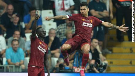 Liverpool's Sadio Mane, left, celebrates after scoring a goal with teammate Roberto Firmino.