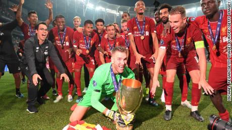 Adrián celebrates with his Liverpool teammates.