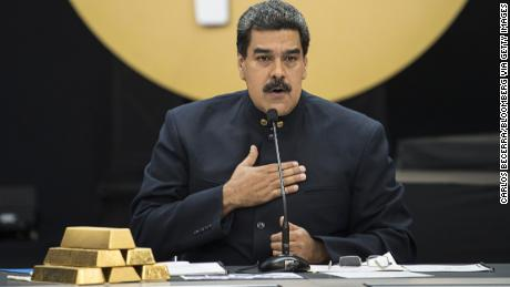 Nicolas Maduro speaks next to a stack of gold ingots during a news conference on the country's cryptocurrency, known as thePetro, in Caracas, Venezuela on March 22, 2018.