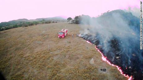 In this August 20, 2019, drone photo released by the Corpo de Bombeiros de Mato Grosso, brush fires burn in Guaranta do Norte municipality, Mato Grosso state, Brazil.