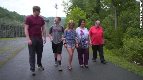 Jacob, Gabriel and Andrianna Riling on a walk with their 70-year-old grandparents, Beverly and Andrew Riling.