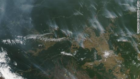A satellite image from NASA shows the fires raging in the Amazon rainforest in Brazil in August 2019.