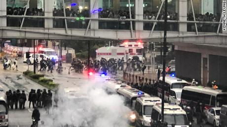 Riot police and protesters face off in the Hong Kong district of Tseun Wan on August 25, 2019.
