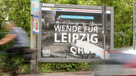 An AfD billboard with a photo of the 1989 Leipzig protests taken by Martin Neuhof's grandfather.