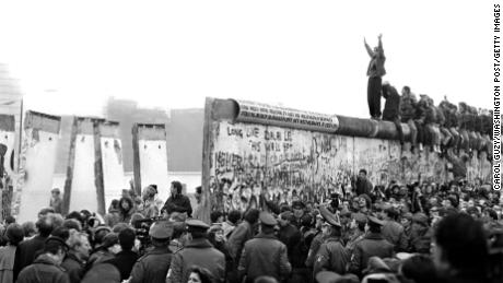The Berlin Wall comes tumbling down in November 1989.