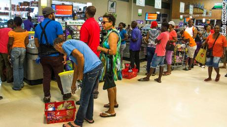 Residents stood in line at a grocery store in Bridgetown, Barbados, on August 26 as Dorian approached the region.