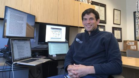 A recent photo of Fajgenbaum in his office at the University of Pennsylvania.