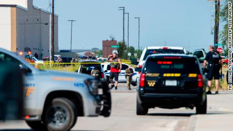 Texas police and sheriff's deputies surround an area behind Cinergy in Odessa after reports of shootings Saturday.