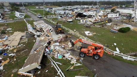 Emerald Isle town employees work to clear the road after a tornado hit Emerald Isle N.C.