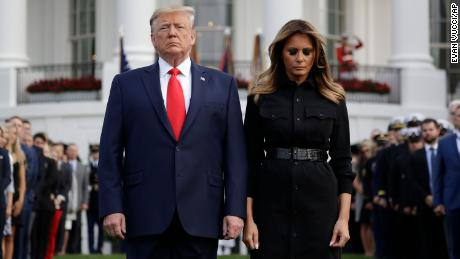 President Donald Trump and first lady Melania Trump participate in a moment of silence on the South Lawn of the White House on Wednesday, honoring the victims of the September 11 terrorist attacks.