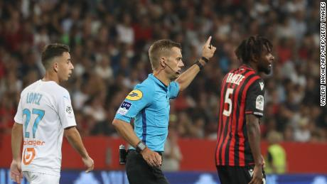 Referee Clement Turpin suspends the game between  Nice and Olympique de Marseille (OM) after persistent homophobic chants and the display of a disparaging banner.