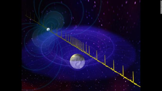 This is an artist's impression of a massive neutron star's pulse being delayed by the passage of a white dwarf star between the neutron star and Earth. Astronomers have detected the most massive neutron star to date due to this delay.