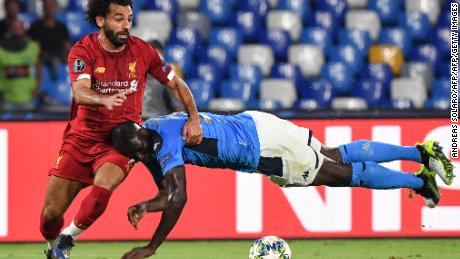 Kalidou Koulibaly puts in an unorthodox challenge to halt Mohamed Salah.