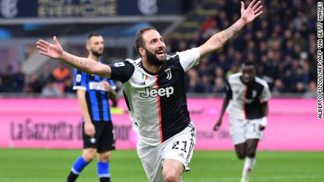 Gonzalo Higuain celebrates his late winner against Inter Milan.