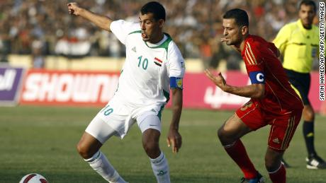 Iraq's Yunis Mahmud (L) challenges Jordan's Bashar Mohammed Amin Mustafa during their 2014 World Cup qualifying clash in Erbil on September 2, 2011.
