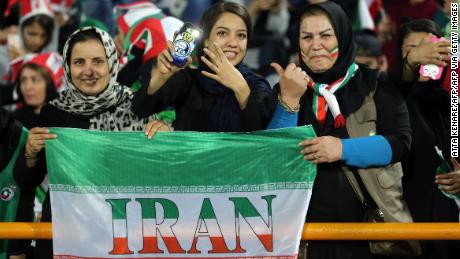 Iranian women cheer during the World Cup qualification match between Iran and Cambodia at the Azadi stadium in the capital Tehran.