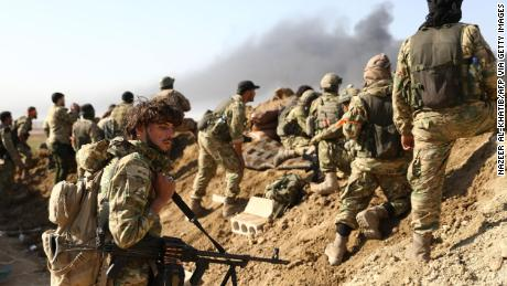 Turkish-backed Syrian rebels and Turkish soldiers during their assault on Kurdish-held border towns in northeastern Syria.