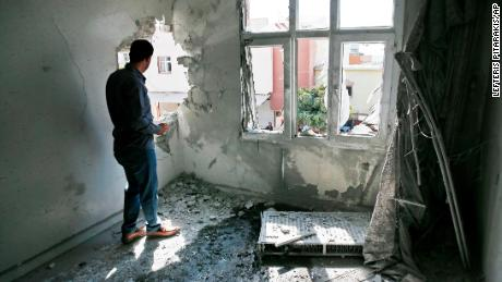 A person inspects the damage from a mortar fired from inside Syria, in Akcakale, southeastern Turkey, on Sunday.