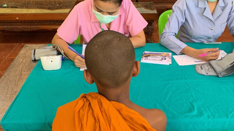 A young monk gets his health checked.