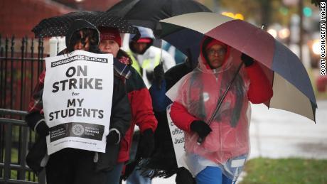 Teachers picketed in the rain outside Oscar DePriest Elementary School in Chicago.