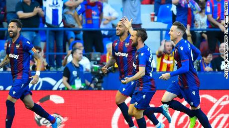 Levante's players celebrate the third goal scored by Nemanja Radoja in the 3-1 victory over Barcelona.