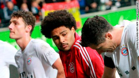 Bayern Munich players react after their side's 5-1 hammering against Eintracht Frankfurt, the team's second league defeat.