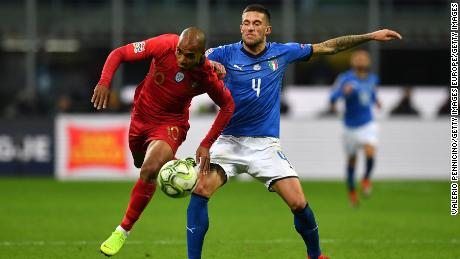 Mario hurdles the challenge of Cristiano Biraghi of Italy during their UEFA Nations League clash.